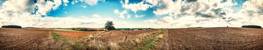 Panoramic agricultural landscape with ploughed field. Nature bac. Panoramic agricultural landscape with ploughed field. Summer nature background Stock Photos