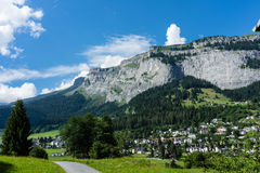 Panoramic alps mountain view with small city Stock Photo