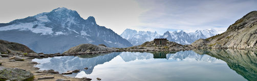Panoramic Alps views. View of Lac Blanc lake to the Mont Blanc mountain range. Lac Blanc is situated in the Aiguille Rouge near Chamonix, France Royalty Free Stock Image