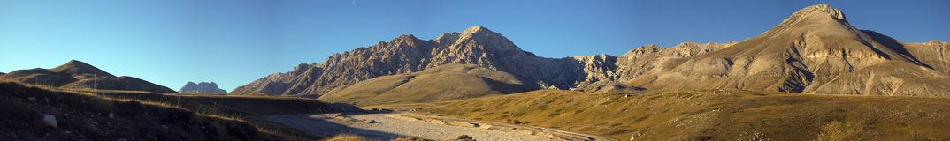 Panoramic Apennines. Panoramic view of Gran Sasso esplanade with blue sky in the background. The Gran Sasso or great stone forms the centerpiece of the Gran royalty free stock photos