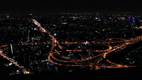Panoramic arial view of beautiful highway road traffic lights at clover junction at night in Bangkok, Thailand. Modern asian metropolis traffic background stock footage