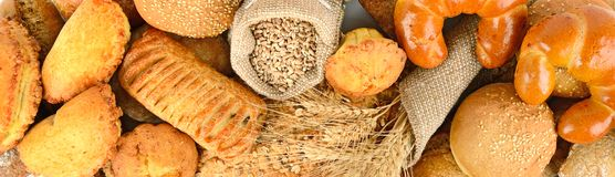 Panoramic background of bread made from wheat and rye flour. Top view stock photography