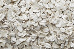 Oatmeal, top view. Texture and background of oatmeal. Healthy eating concept stock images