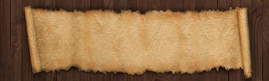 Panoramic background of old paper. Unfolded scroll on the table Stock Photos