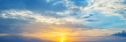 Panoramic view of a cloudy sky at sunset stock images