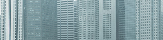 Panoramic background - windows of high-rise city buildings Royalty Free Stock Image