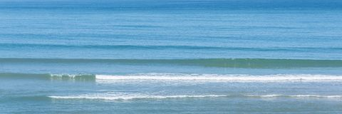 Panorama of the ocean with small waves stock photography