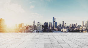 Panoramic Bangkok city in sunrise with concrete floor Royalty Free Stock Photos