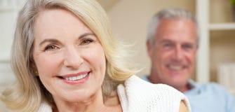 Happy Senior Man & Woman Couple Smiling at Home stock photo