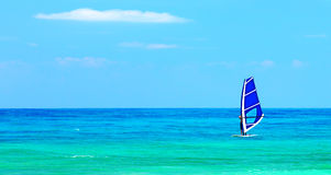 Panoramic beach landscape with windsurfer playing Stock Photos