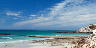Panoramic of beach on a rocky coast Stock Image