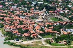 Panoramic beautiful aerial view of Mtskheta with the rivers Kura and Aragvi, Svetitskhoveli Cathedral and castle complex. In summer day in Mtskheta, Georgia Royalty Free Stock Photography