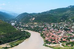 Panoramic beautiful aerial view of Mtskheta with the rivers Kura and Aragvi, Svetitskhoveli Cathedral and castle complex. In summer day in Mtskheta, Georgia Stock Images