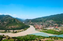 Panoramic beautiful aerial view of Mtskheta with the rivers Kura and Aragvi, Svetitskhoveli Cathedral and castle complex. In summer day in Mtskheta, Georgia Royalty Free Stock Photos