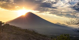 Panoramic beautiful view view of the mountains at sunset. evening cloudy view of the volcano ?gung, Bali royalty free stock photo