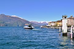 Beautiful panoramic view to ferry boat moving on the lake Como at Bellagio in early spring sunny day. royalty free stock image