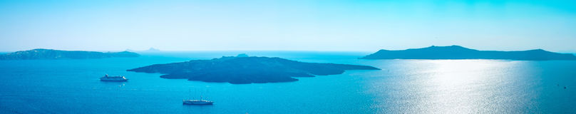Panoramic bird eye aerial view of white building, sky and sea in Santorini island, Oia, Greece Stock Images