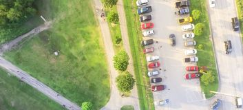 Panoramic bird eye view busy parking lots near highway at park e royalty free stock images