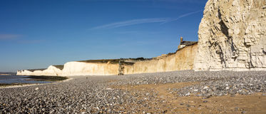 Panoramic view of chalk cliffs and an empty pebble beach Stock Images