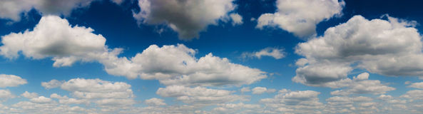 Panoramic blue sky background with white clouds Stock Photos