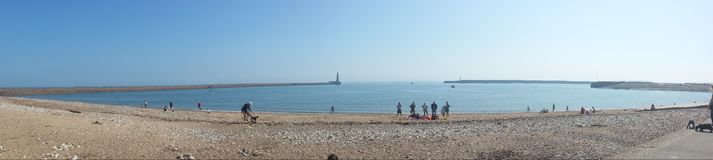 Panoramic Blue Sky British Beach Pier Lighthouse royalty free stock images