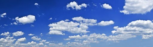 Panoramic blue sky with white clouds Royalty Free Stock Image