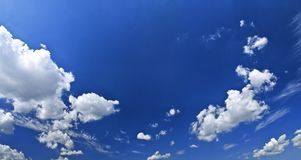 Panoramic blue sky with white clouds Royalty Free Stock Photo