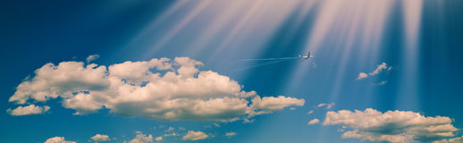 Panoramic, Blue summer skies. With white clouds and flying jet royalty free stock image