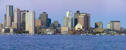 Panoramic of Boston Harbor and the Boston skyline at sunrise as seen from South Boston, Massachusetts, New England Stock Photo