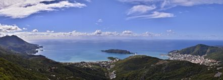 Panoramic of Budva, Montenegro with the Adriatic Sea. A panoramic style background photograph of the coastal area of the Adriatic Sea featuring a wide angle view stock photo