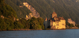 Panoramic with Chateau de Chillon 11, Switzerland. Golden hour view of Chateau de Chillon and the surrounding waterfront of Lake Geneva (Lake Leman) in panoramic Royalty Free Stock Photo