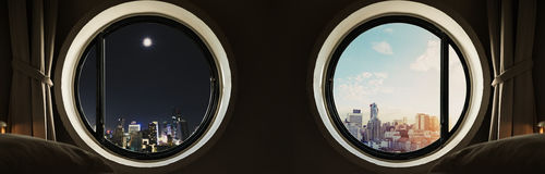 Panoramic circle window with modern buildings city at night and day in sunrise Stock Images