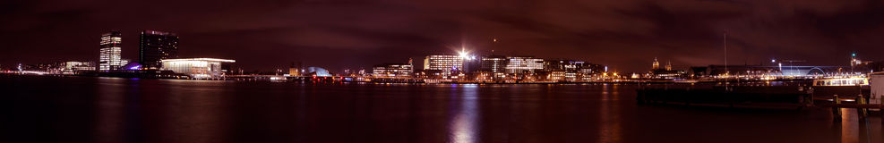 Panoramic city scenic from Amsterdam Netherlands. Panoramic city scenic with the Music building and central station at night in Amsterdam the Netherlands Royalty Free Stock Image