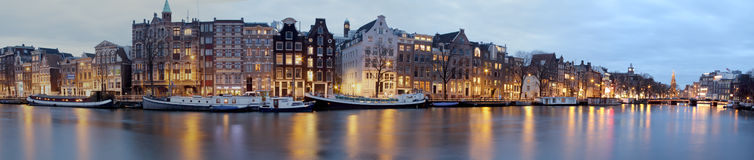 Panoramic city scenic in Amsterdam the Netherlands. Panoramic city scenic in Amsterdam with the Munt Tower in the Netherlands at night Royalty Free Stock Photography