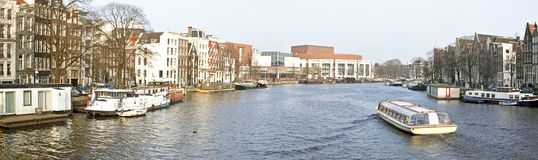 Panoramic city view in Amsterdam Netherlands. Panoramic city view with the Thiny bridge in Amsterdam the Netherlands Stock Photos