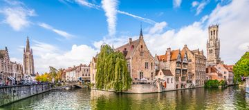 Panoramic city view Belfry tower and famous canal in Bruges, Belgium. royalty free stock photography