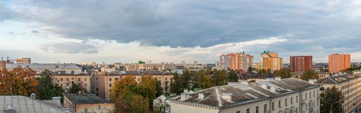 Panoramic city view with old and modern buildings under the autumn cloudy sky Royalty Free Stock Image