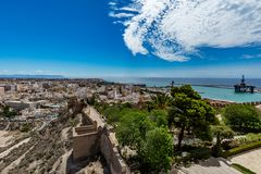 Panoramic cityscape of Almeria with the walls of Alcazaba (Castle) Stock Photos