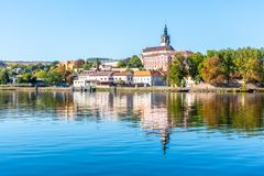 Panoramic cityscape of Litomerice reflected in Labe River, Czech Republic.  royalty free stock image