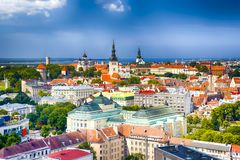 Panoramic Cityscape View of Tallinn City on Toompea Hill in Estonia. Shot Covers Lines of Traditional Red Roofs of Medieval House. S, Towers, Cathedral and stock photos