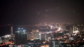 Panoramic of cityscape view from top of the hill or mountain during night with changes focus to blurred bokeh lights stock video