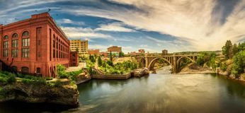 Washington Water Power building and the Monroe Street Bridge in Spokane. Panoramic cityscape view of Washington Water Power building and the Monroe Street Bridge royalty free stock photography