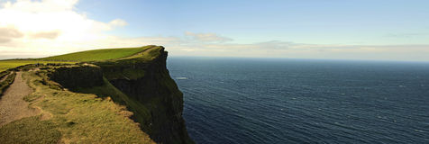 Panoramic Cliffs of Moher. Magnificent view of the Cliffs of Moher in Ireland Royalty Free Stock Photography