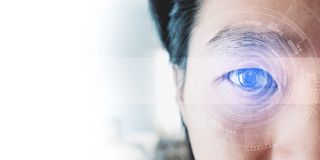 Panoramic close-up Asian businessman`s eye , with futuristic technology visual effect Stock Photo
