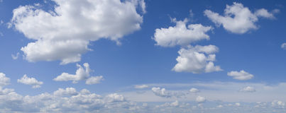Panoramic clouds. Big panoramic blue sky with white sunny clouds Royalty Free Stock Photo