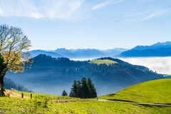 Panoramic cloudscape skyline view of Swiss Alps in blue sky. Royalty Free Stock Photography