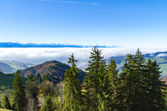 Panoramic cloudscape skyline view of Swiss Alps in blue sky. Stock Images