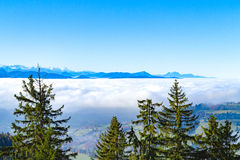 Panoramic cloudscape skyline view of Swiss Alps in blue sky. Royalty Free Stock Photo