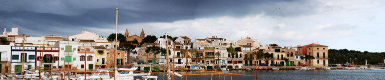 Panoramic coast village. Panoramic view of a coast village in Mallorca on a cloudy day Royalty Free Stock Photography