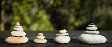 Panoramic composition with four stacking of stones stock photos